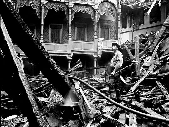 Nashville firefighter Marlon Claiborne inspects the still smoldering ruins of the 1,200-seat auditorium of the 80-year-old Loew's Vendome Theater on Aug. 9, 1967. The theater was gutted and the roof caved in by flames that raged out of control from about 2 a.m. until 5 a.m.