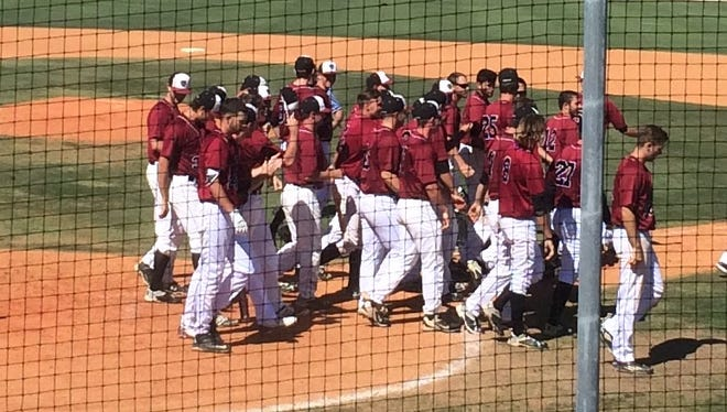 The Florida Tech baseball team celebrates the win in Game 1 of the doubleheader with Barry.