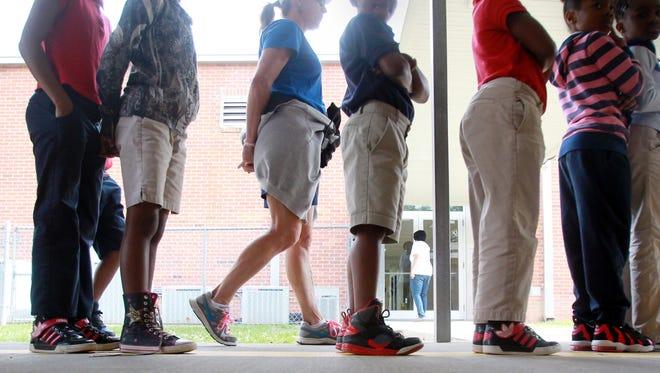 Second-grade students line up school in Lafayette.