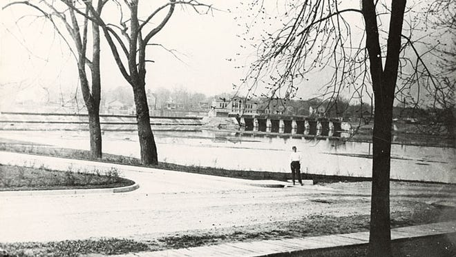 This photograph, circa 1915, facing south from the Lincoln Street entrance of Theda Clark Hospital, shows the Neenah Dam, the Neenah Public Library and the homes along East Wisconsin Avenue.