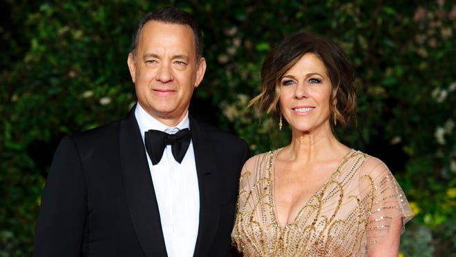 Tom Hanks and wife Rita Wilson (pictured Feb. 16, 2014, at the British Academy Film Awards 2014 After Party in London) will host this year's National Christmas Tree lighting in President's Park near the White House on Dec. 4.