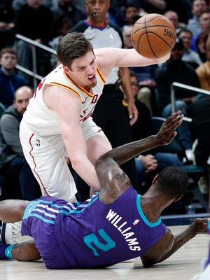 Indiana Pacers forward T.J. Leaf (22) is fouled by Charlotte Hornets forward Marvin Williams (2) in the second half of their game at Bankers Life Fieldhouse on Tuesday, April 10, 2018. The Charlotte Hornets defeated the Indiana Pacers 119-93.