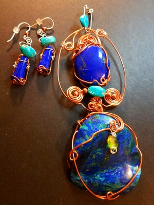 Reconfigured Art Jewelry by Jacque Hillman: Turquoise, lapis lazuli, peridot and chrysocolla wrapped in copper.