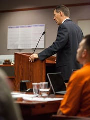 Iron County Attorney Scott Garrett questions a witness
