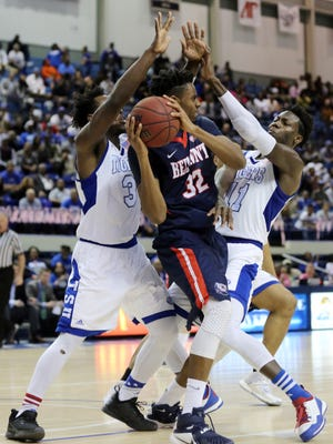 Belmont's Amanze Egekeze is double-teamed by TSU's Xavier Richards, left, and Demontez Loman, right, during their game Sunday at Gentry Center.