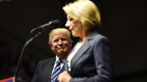 Sen. Sherrod Brown on Wednesday called on President-elect Donald Trump's nominee for education secretary, Betsy DeVos, to pay a campaign finance fine owed to Ohio before her confirmation hearings.