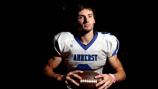 Josh Cisewski, a senior at Amherst High School, is a dynamic option for passes through the game, and a key player on the road to state competition. He is photographed in Amherst, Wisconsin, the day before the football team heads to state competition in Madison.