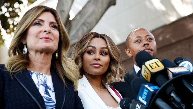 Blac Chyna, center, won a temporary restraining order against ex-fiancé Rob Kardashian after he published nude photos of her and accused her of cheating.