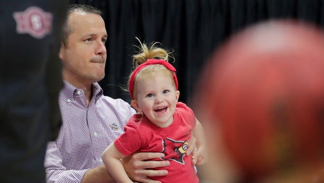 Louisville's Jeff Walz and his daughter Lucy before the game against Stanford.