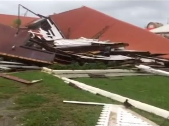 This image made from a video, shows parliament house damaged by Cyclone Gita in Nuku'alofa, Tonga Tuesday, Feb. 13, 2018. Tonga began cleaning up Tuesday after a cyclone hit overnight, while some people in the nearby Pacific nation of Fiji began preparing for the storm to hit them. (TVNZ via AP)