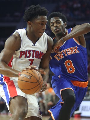 Pistons forward Stanley Johnson drives against Knicks guard Justin Holiday in the fourth quarter of the Pistons' 102-89 win Nov. 1, 2016 at the Palace.