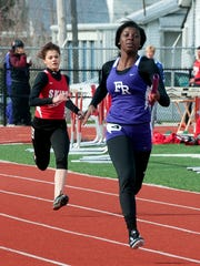 Fremont Ross' Vanashia Elkins runs the final leg of