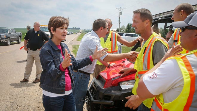 Iowa Gov. Kim Reynolds meets with emergency officials and volunteers at the staging area near the site of the BNSF Railway derailment on Saturday, June 23, 2018, in Doon.