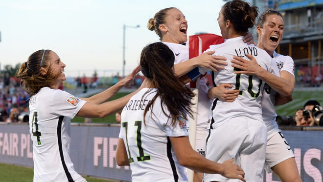 June 26, 2015; Ottawa, Ontario; United States midfielder Carli Lloyd (10) celebrates her goal with teammates against China during the second half in the quarterfinals of the FIFA 2015 Women's World Cup at Lansdowne Stadium.