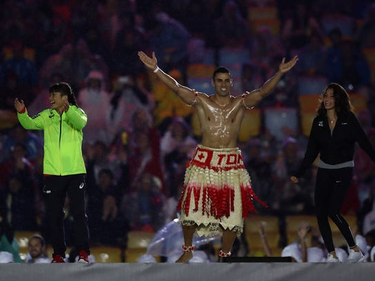 Pita Taufatofua of Tonga jumps on stage during the