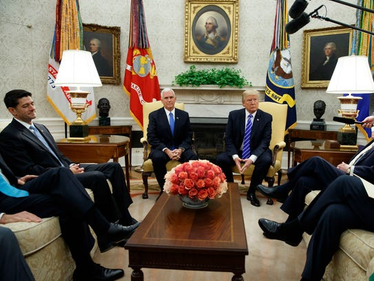 President Trump pauses during a meeting with congressional
