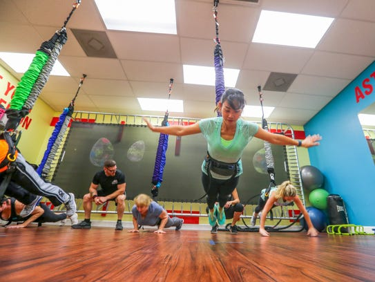 Charinee Bangthamai and other classmates in the Astro-Durance class do flying pushups. Last July, Patty Cummings launched her bungee workout system brand, Astro-Durance. She had 1,500 square feet of strip mall space, two full-time employees and was dealing in Florida. Less than a year later, she has leased 5,000 square feet of space, hired 13 more full-time employees and shopped her product to 33 states.