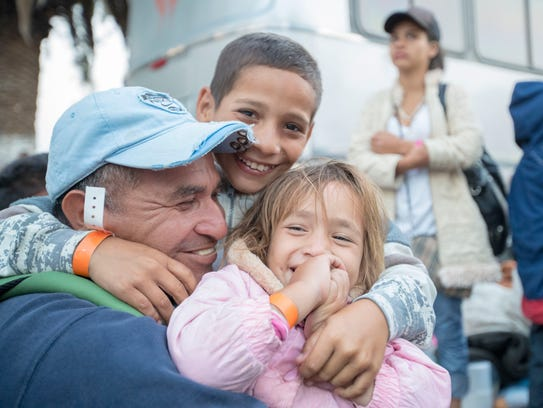 Migrants from Central America are boarding buses in