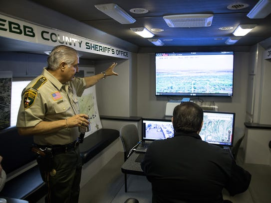 Webb County Sheriff Martin Cuellar, left, gives a demonstration of Operation Border SMART during an interview outside his office in Laredo, Texas, on April 9, 2018. Cuellar said he welcomed more personnel on the border if they're helping behind the scenes, though a better use of money would be to fund technology-based initiatives.