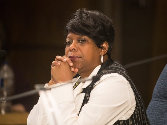 Wilmington Councilwoman Zanthia Oliver watches on during