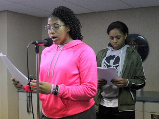 St. E sophomore Ardavia Lee recorded the role of the narrator for today's Passion Sunday broadcast. Senior Dymond Collins, background, recorded the role of Judas.