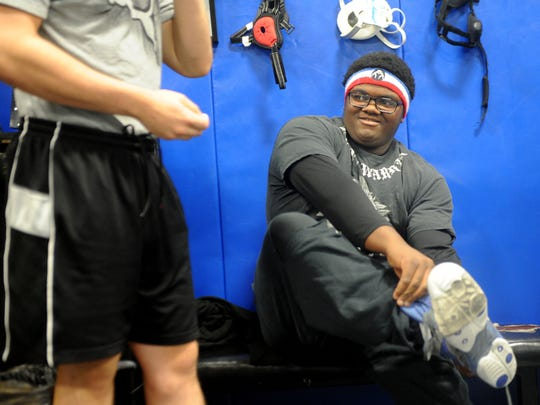 Elijah Jackson-Clark, 17, suffered a concussion as a freshman football player at Buena High School. That injury led him to give wrestling a try and he's now in his third season and undefeated.