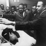 Civil rights leader Ralph Abernathy and Andrew Young close the casket bearing the body of Martin Luther King Jr.