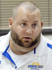 Kennard-Dale coach Chris Grube speaks to reporters