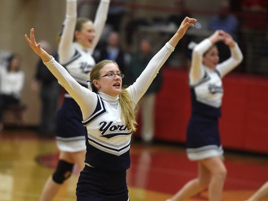 Christian School of York cheerleaders cheer on the