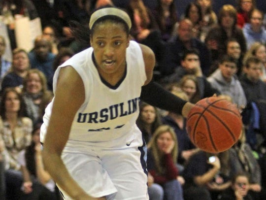 Ursuline's Alyssa Lawrence drives to the hoop during