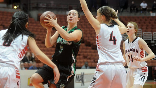 Thousand Oaks High's Lizzy Buzzelli splits the Glendora defense during the Lancers' 62-52 win in the CIF-SS Division 3AA final Saturday at the Honda Center in Anaheim. The Lancers are the No. 8 seed in South Division III of the state tournament and will host No. 9 Righetti in a first-round contest Wednesday.