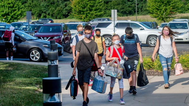 A group of students walk in from the parking lot on the first day of school Monday, Aug. 17, 2020 at Dunlap Valley Middle School in Dunlap. Students began full-day, in-person learning Monday in Dunlap District 323.