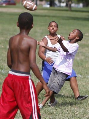 Kids play flag football at Heekin Park in this file photo.
