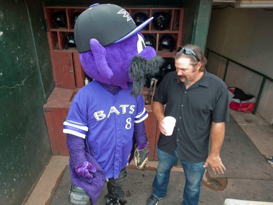 Corky Miller hangs out with Buddy the Bat, who was dressed with a big mustache and No. 8 jersey in honor of the Louisville Bats' retirement of Miller's uniform number on Aug. 31, 2014.