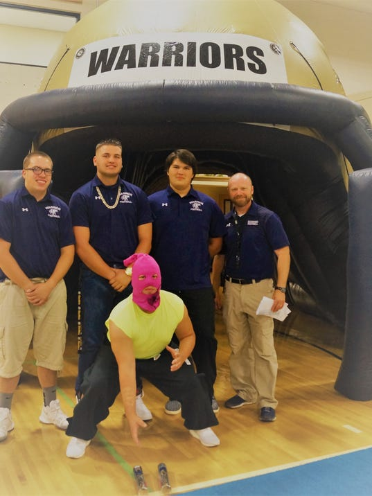 Ruidoso High School Warriors and football coach Kief Johnson (far right) at homecoming pep rally Friday.