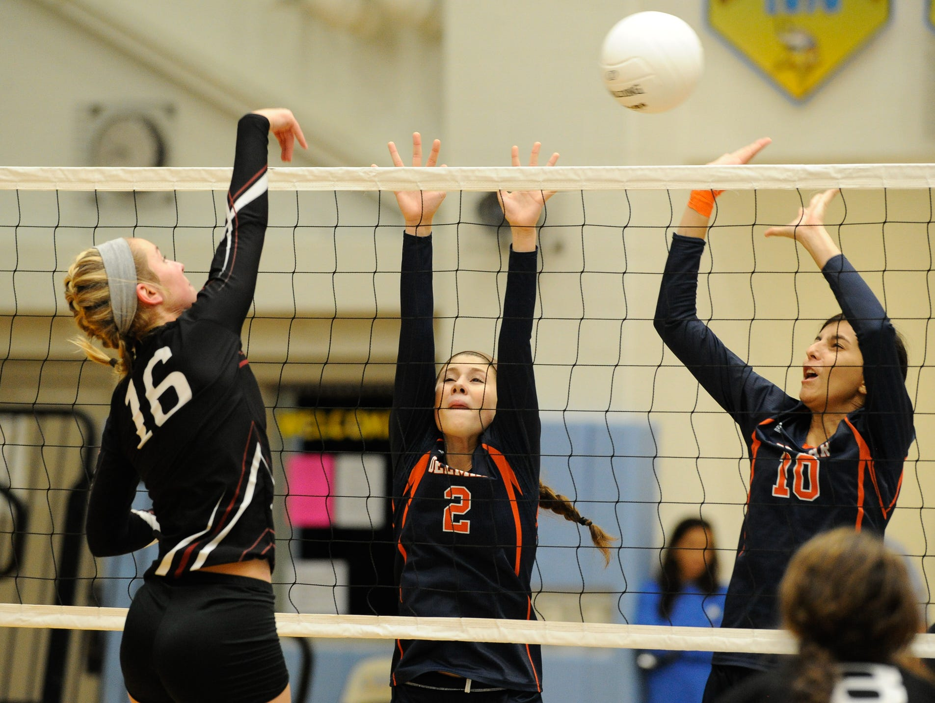 Appoquinimink's #16 Emily Aniunas jumps up for a spike in their game against Delmar, Thursday night at Cape Henlopen High School.