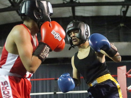 Adrian Aguilar, right, fights against Victor Rodriguez in their Junior Olympic 105-110-pound bout Sunday at the 2016 Golden Gloves boxing tournament at the El Paso County Coliseum. Rodriguez won the bout and a first place trophy.