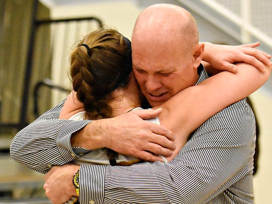Coach Don Dimoff hugs his daughter Courtney Dimoff