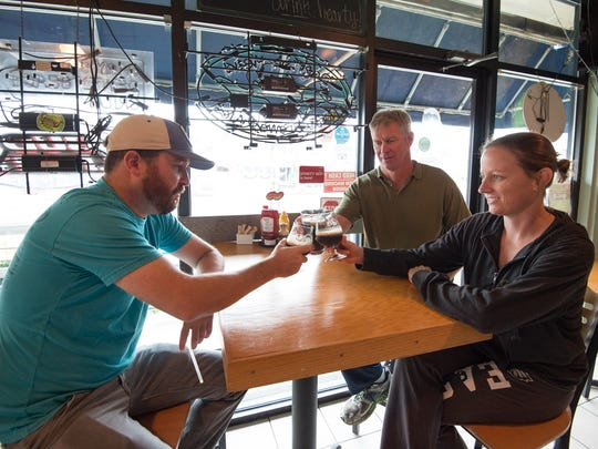 Co-owners of Gary's Dewey Beach Grill, Adam Newman, left, Gary Cannon, Holly Ski and Chris Avsec (not pictured) have started a brewery called 38°-75° Brewing.