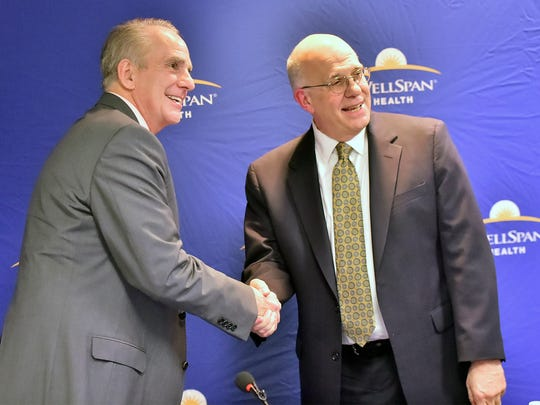 Patrick O'Donnell, left, CEO/President Summit Health and Dr. Kevin Mosser, WellSpan, CEO/President shake hands following press conference on Tuesday, April 3, 2018 at Chambersburg Hospital. Summit Health and WellSpan Health are working towards a potential affiliation.