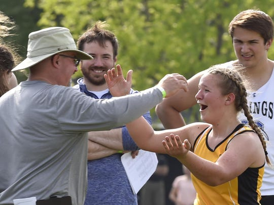 Algoma throws coach Dean Blahnik congratulates daughter Bobbi Blahnik after she recorded a personal best of 40 feet during the finals of the WIAA Division 3 sectional meet at Hilbert on Thursday, May 24, 2018. She advances to state after finishing third with the mark.