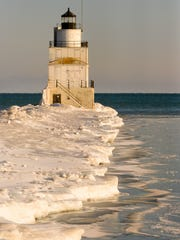 File photo of Lake Michigan ice formations along the breakwater pier to the Manitowoc Lighthouse in February 2015. File/USA TODAY NETWORK-Wisconsin