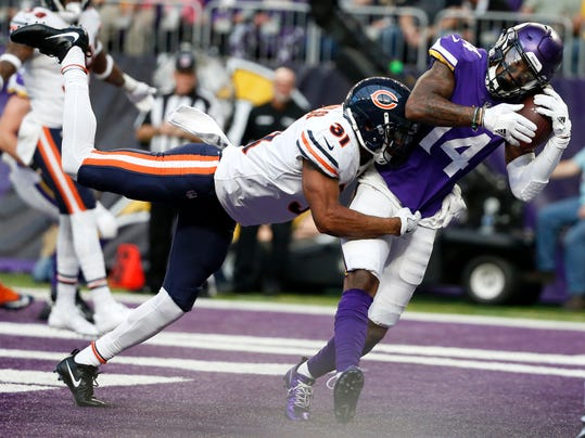 Minnesota Vikings wide receiver Stefon Diggs (14) catches a 15-yard touchdown pass over Chicago Bears cornerback Marcus Cooper (31) during the second half of an NFL football game, Sunday, Dec. 31, 2017, in Minneapolis. (AP Photo/Bruce Kluckhohn)