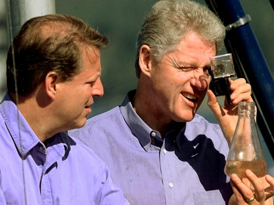 INCLINE VILLAGE, UNITED STATES:  US President Bill Clinton (R) along with Vice President Al Gore (L) look at water samples aboard the U.C. Davis Research Vessel on Lake Tahoe 26 July in Lake Tahoe, Nevada. Clinton will sign an Executive Order on Lake Tahoe Preservation.   (ELECTRONIC IMAGE)                                  AFP PHOTO  STEPHEN JAFFE (Photo credit should read STEPHEN JAFFE/AFP/Getty Images)