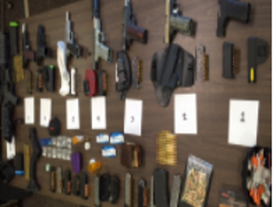 Guns and drugs seized from a car driven by Ken Suwabe
