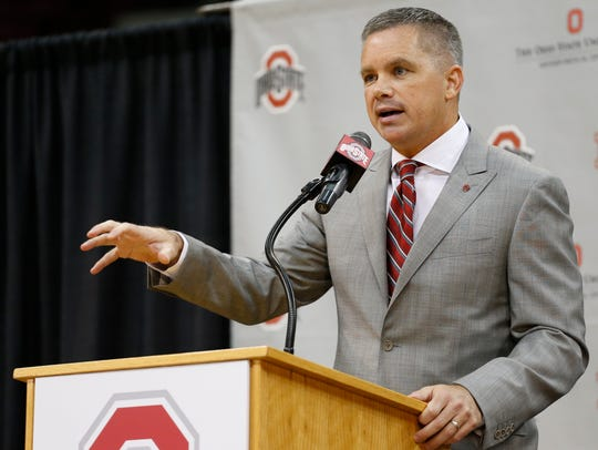 Chris Holtmann answers questions during a NCAA college