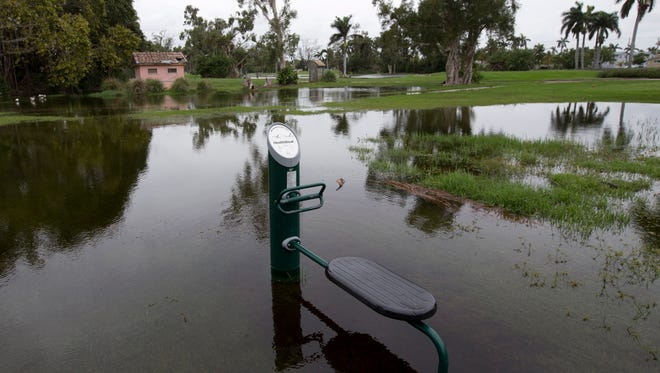 A piece of exercise equipment lies partially submerged Monday, May 21, 2018, in Hollywood, Fla. Rainy season hit South Florida with full force over the weekend, with more rain forecast for the Memorial Day weekend.