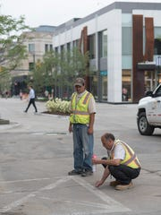 Final work is being completed on the streets of downtown