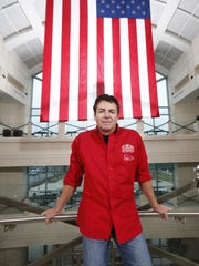 John Schnatter stands in the lobby at Papa John's headquarters in 2016.