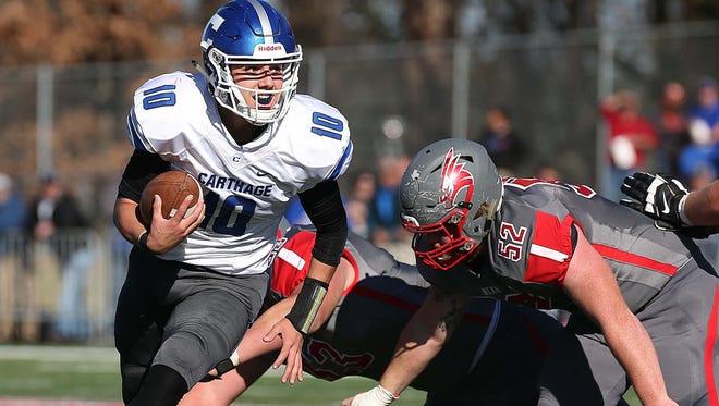 Carthage's Alex Derryberry gets past the Nixa defense on November 14, 2015.